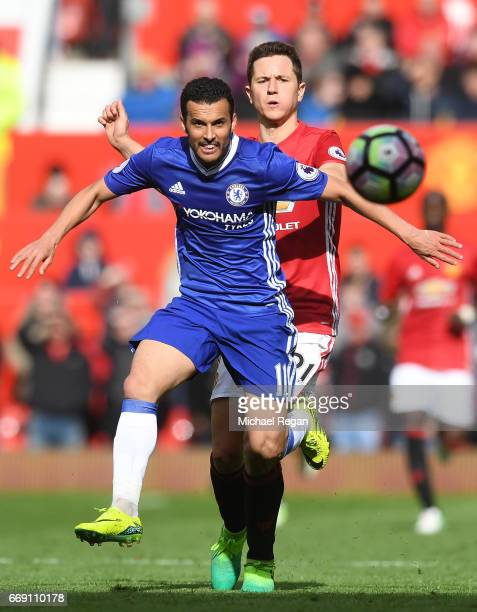 Pedro of Chelsea is put under pressure from Ander Herrera of Manchester United during the Premier League match between Manchester United and Chelsea...