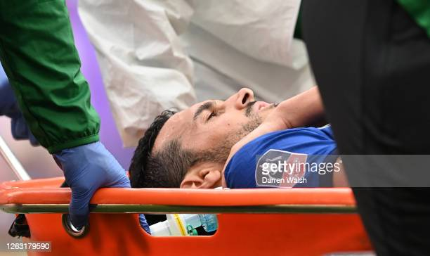 Pedro of Chelsea is stretchered off the pitch after an injury to his shoulder during the Heads Up FA Cup Final match between Arsenal and Chelsea at...