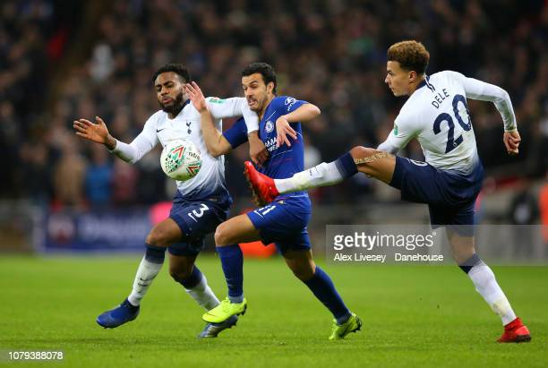 Pedro of Chelsea is tackled by Danny Rose and Dele Alli of Tottenham Hotspur during the Carabao Cup semifinal first leg match between Tottenham...