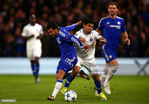 Pedro of Chelsea is tackled by Jesus Manuel Corona of FC Porto during the UEFA Champions League Group G match between Chelsea FC and FC Porto at...