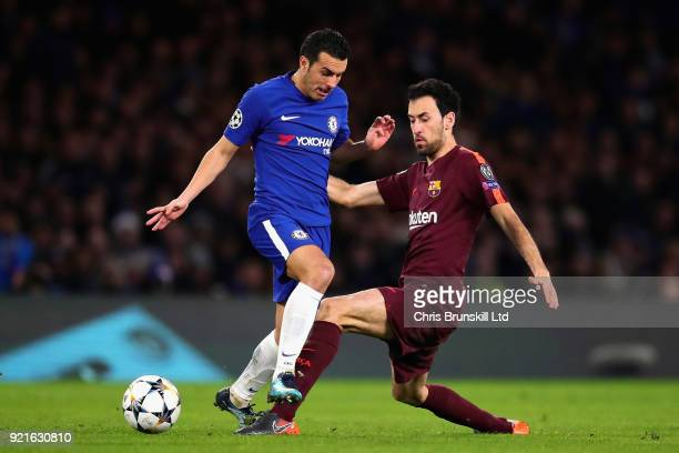 Pedro of Chelsea is tackled by Sergio Busquets of FC Barcelona during the UEFA Champions League Round of 16 First Leg match between Chelsea FC and FC...