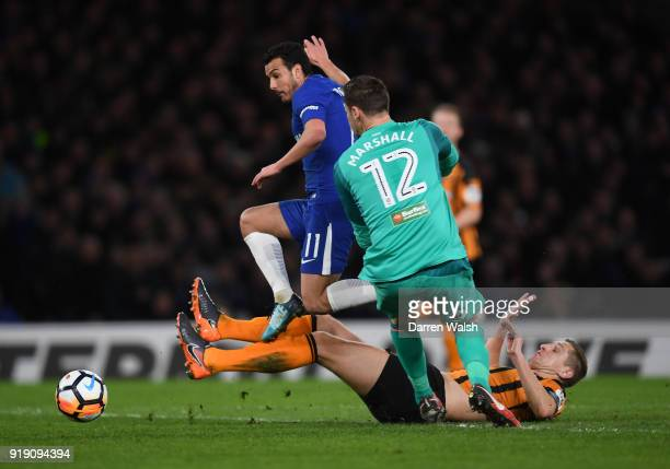 Pedro of Chelsea jumps over the teackles of Michael Dawson and David Marshall of Hull City during the Emirates FA Cup Fifth Round match between...