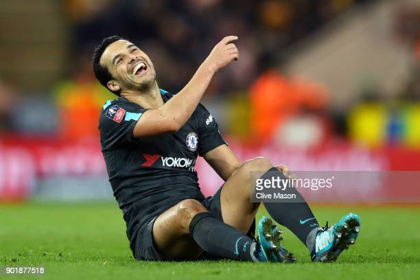 Pedro of Chelsea laughs after going to ground during The Emirates FA Cup Third Round match between Norwich City and Chelsea at Carrow Road on January...