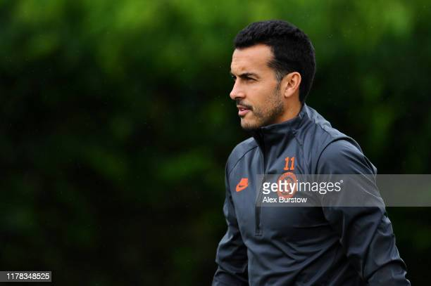 Pedro of Chelsea looks on as he walks out prior to the Chelsea FC training session on the eve of the UEFA Champions League match between Lille OSC...