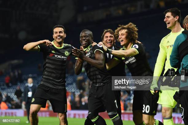 Pedro of Chelsea N'Golo Kante of Chelsea David Luiz of Chelsea and Antonio Conte Manager of Chelsea celebrate winning the league after the Premier...