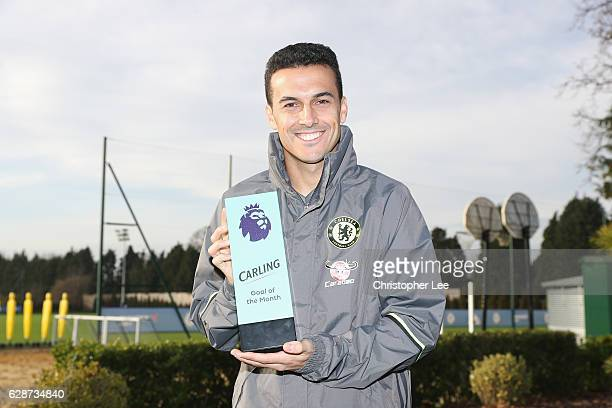 Pedro of Chelsea poses with his Goal of the Month award as Chelsea receive the Monthly Premier League Awards at Chelsea Training Ground on December 9...