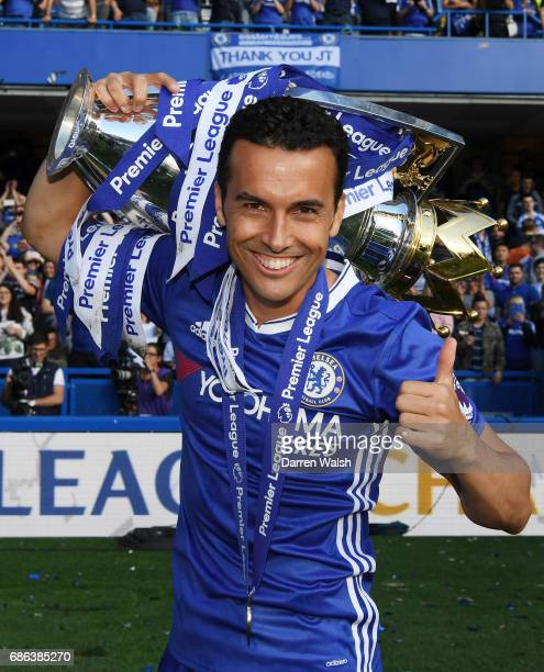 Pedro of Chelsea poses with the Premier League Trophy after the Premier League match between Chelsea and Sunderland at Stamford Bridge on May 21 2017...
