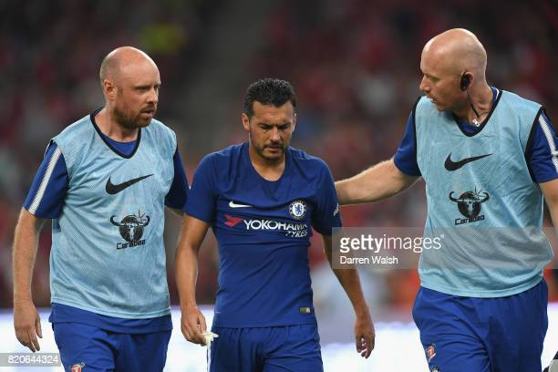 Pedro of Chelsea receives treatment after being caught by David Ospina of Arsenal during the PreSeason Friendly match between Arsenal FC and Chelsea...