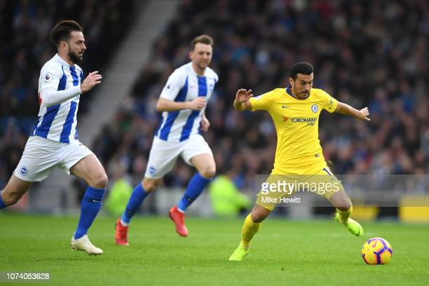 Pedro of Chelsea runs with the ball during the Premier League match between Brighton Hove Albion and Chelsea FC at American Express Community Stadium...