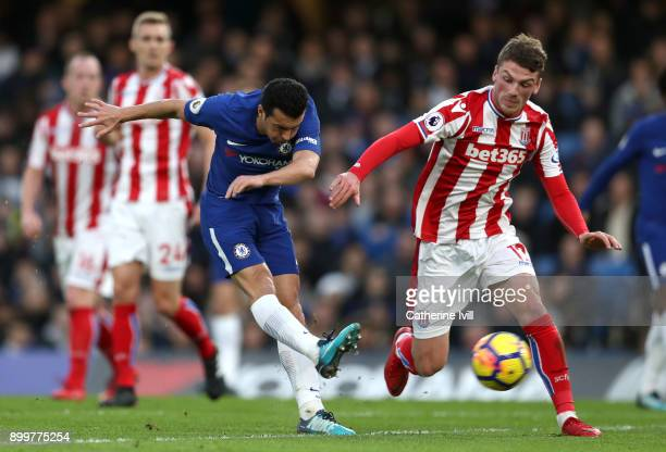 Pedro of Chelsea scores his sides third goal during the Premier League match between Chelsea and Stoke City at Stamford Bridge on December 30 2017 in...