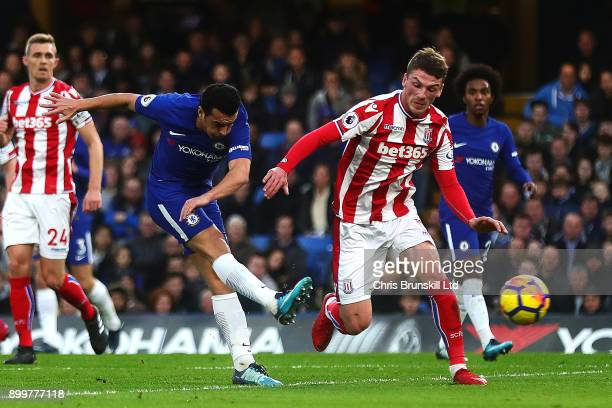 Pedro of Chelsea scores his side's third goal during the Premier League match between Chelsea and Stoke City at Stamford Bridge on December 30 2017...