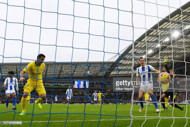 Pedro of Chelsea scores his team's first goal during the Premier League match between Brighton Hove Albion and Chelsea FC at American Express...