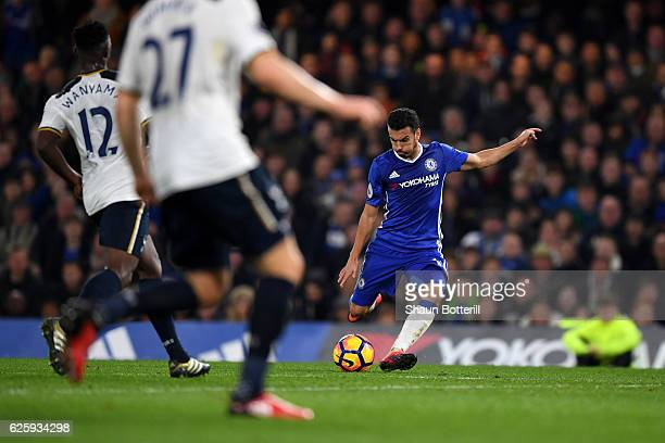 Pedro of Chelsea scores his team's first goal during the Premier League match between Chelsea and Tottenham Hotspur at Stamford Bridge on November 26...
