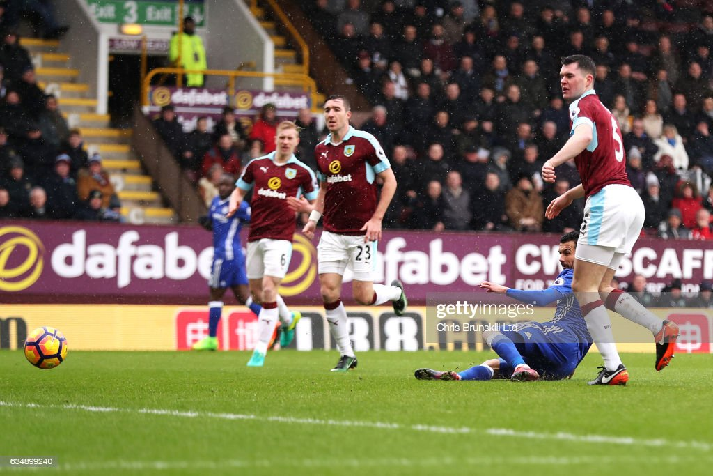 Pedro of Chelsea scores the opening goal during the Premier League match between Burnley and Chelsea at Turf Moor on February 12, 2017 in Burnley, England.