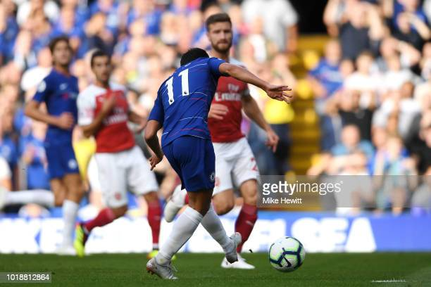Pedro of Chelsea shoots and scores his side's first goal during the Premier League match between Chelsea FC and Arsenal FC at Stamford Bridge on...