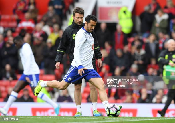 Pedro of Chelsea shoots during the Premier League match between Manchester United and Chelsea at Old Trafford on April 16 2017 in Manchester England