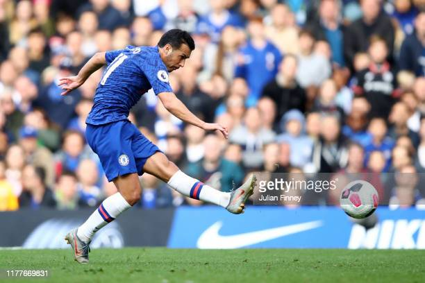 Pedro of Chelsea shoots during the Premier League match between Chelsea FC and Brighton & Hove Albion at Stamford Bridge on September 28, 2019 in...