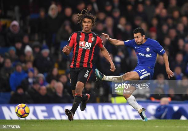 Pedro of Chelsea shoots under pressure from Nathan Ake of AFC Bournemouth during the Premier League match between Chelsea and AFC Bournemouth at...