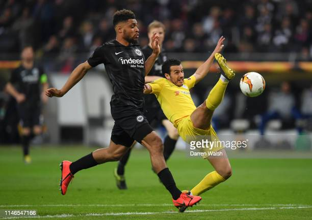 Pedro of Chelsea strethces for the ball ahead of Simon Falette of Eintracht Frankfurt during the UEFA Europa League Semi Final First Leg match...