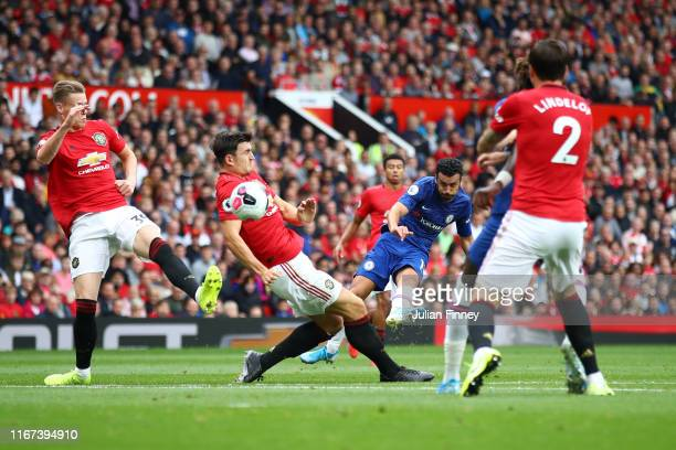 Pedro of Chelsea strikes the ball through the Manchester United defence during the Premier League match between Manchester United and Chelsea FC at...