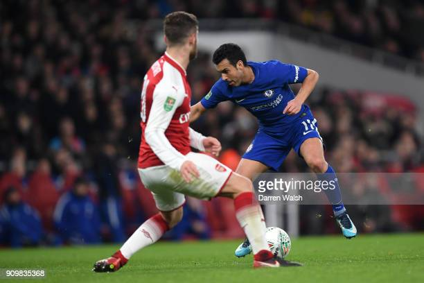 Pedro of Chelsea takes on Granit Xhaka of Arsenal during the Carabao Cup SemiFinal Second Leg at Emirates Stadium on January 24 2018 in London England