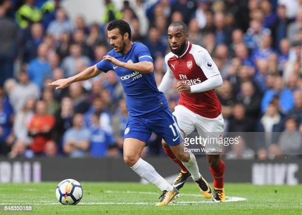 Pedro of Chelsea takes the ball away from Alexandre Lacazette of Arsenal during the Premier League match between Chelsea and Arsenal at Stamford...