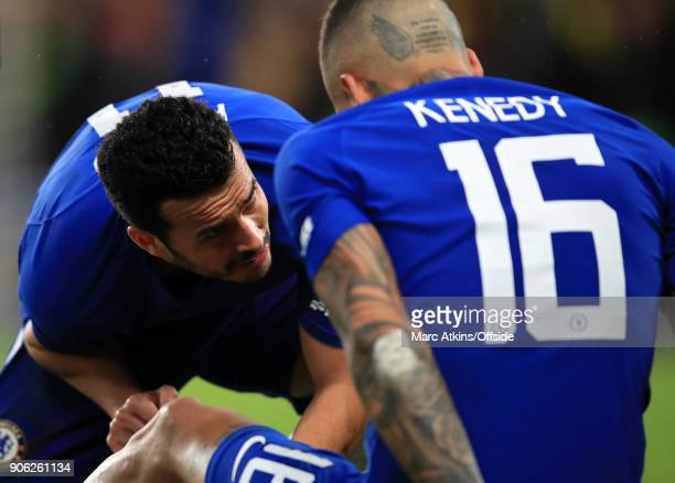 Pedro of Chelsea tends to injured teammate Kenedy during the Emirates FA Cup Third Round Replay match between Chelsea and Norwich City at Stamford...