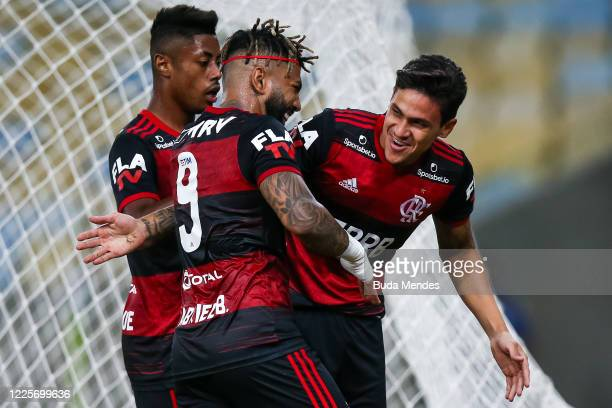 Pedro of Flamengo celebrates with his teammates Gabriel Barbosa and Bruno Henrique after scoring the first goal of his team during the match between...