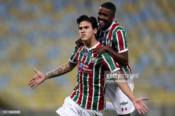 Pedro of Fluminense celebrates with teammate Matheus Alessandro after scoring the first goal against Bahia during a match between Fluminense and...