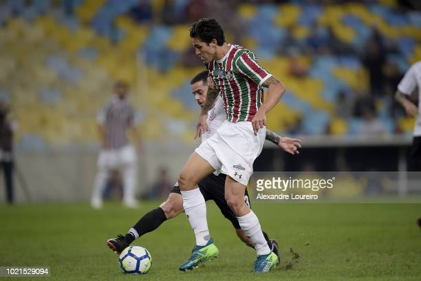 Pedro of Fluminense struggles for the ball with Fagner of Corinthians during the match between Fluminense and Corinthians as part of Brasileirao...