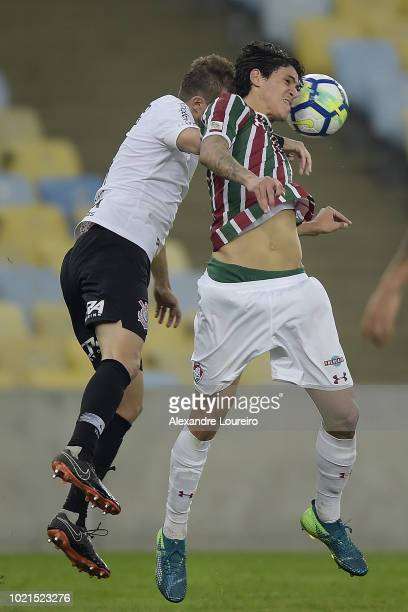 Pedro of Fluminense struggles for the ball with Henrique of Corinthians during the match between Fluminense and Corinthians as part of Brasileirao...