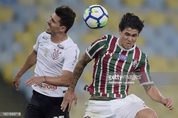 Pedro of Fluminense struggles for the ball with Pedro Henrique of Corinthians during the match between Fluminense and Corinthians as part of...