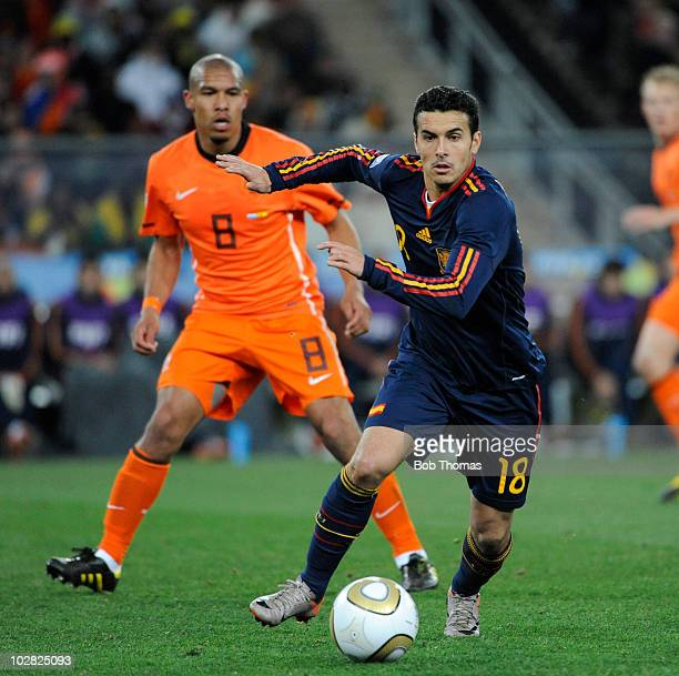 Pedro of Spain moves away from Nigel De Jong of the Netherlands during the 2010 FIFA World Cup Final between the Netherlands and Spain on July 11...