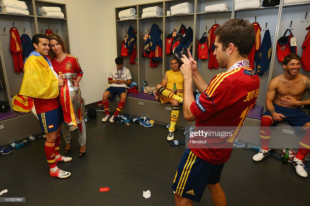 Pedro of Spain poses with the trophy in the dressing room following the UEFA EURO 2012 final match between Spain and Italy at the Olympic Stadium on July 1, 2012 in Kiev, Ukraine.