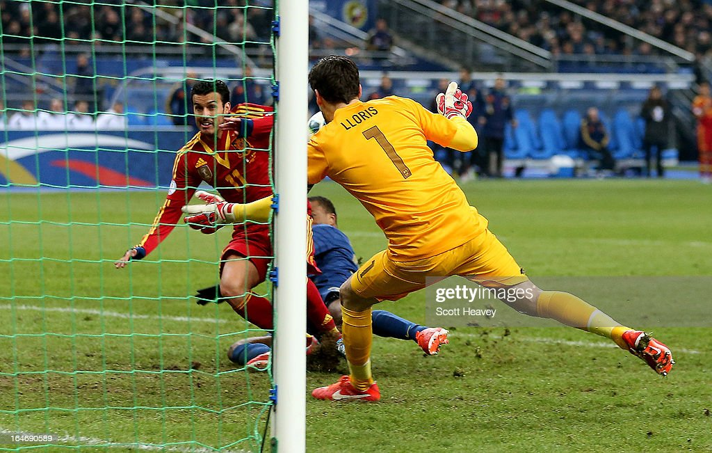 Pedro of Spain scores their first goal during a FIFA 2014 World Cup Qualifier between France and Spain at Stade de France on March 26, 2013 in Paris, France.