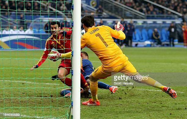 Pedro of Spain scores their first goal during a FIFA 2014 World Cup Qualifier between France and Spain at Stade de France on March 26 2013 in Paris...