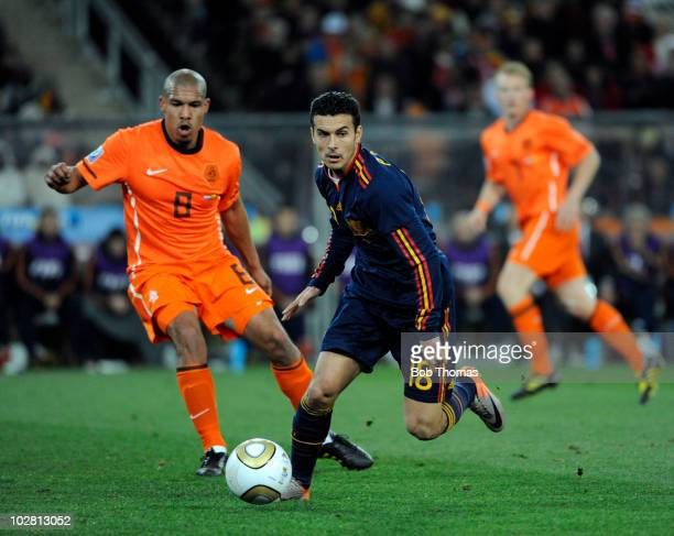 Pedro of Spain with Nigel De Jong of the Netherlands during the 2010 FIFA World Cup Final between the Netherlands and Spain on July 11 2010 in...
