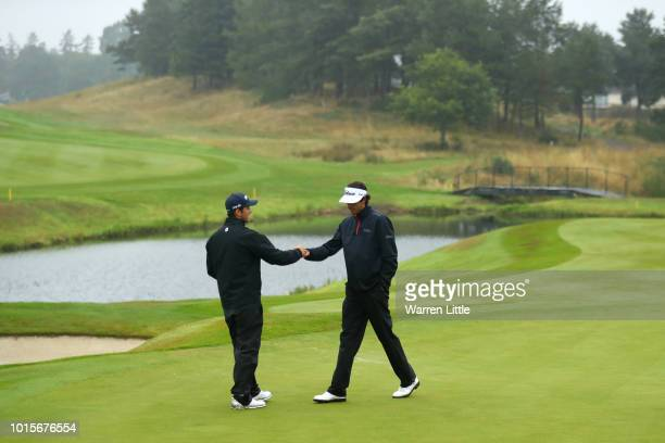 Pedro Oriol and Scott Fernandez of Spain celebrate on the 18th hole during the team competition men foursomes gold medal match between Iceland and...