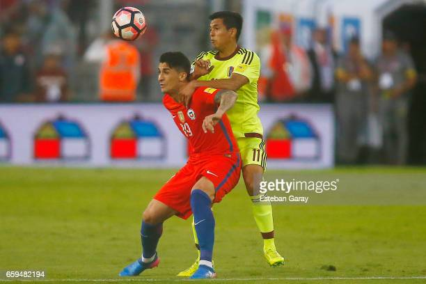 Pedro Pablo Hernandez of Chile fights for the ball with Renzo Zambrano of Venezuela during a match between Chile and Venezuela as part of FIFA 2018...