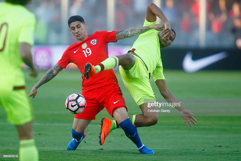 Pedro Pablo Hernandez of Chile fights for the ball with Salomon Rondon of Venezuela during a match between Chile and Venezuela as part of FIFA 2018 World Cup Qualifier at Monumental Stadium on March 28, 2017 in Santiago, Chile.