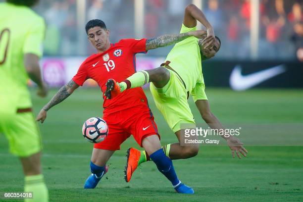 Pedro Pablo Hernandez of Chile fights for the ball with Salomon Rondon of Venezuela during a match between Chile and Venezuela as part of FIFA 2018...