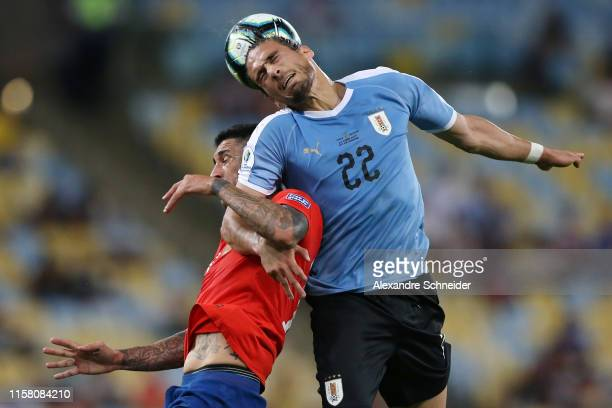 Pedro Pablo Hernandez of Chile heads for the ball with Martin Caceres of Uruguay during the Copa America Brazil 2019 group C match between Chile and...