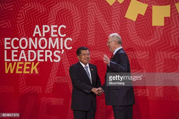 Pedro Pablo Kuczynski, Peru's president, right, greets Jusuf Kalla, Indonesia's vice president, during the Asia-Pacific Economic Cooperation 2016 CEO...