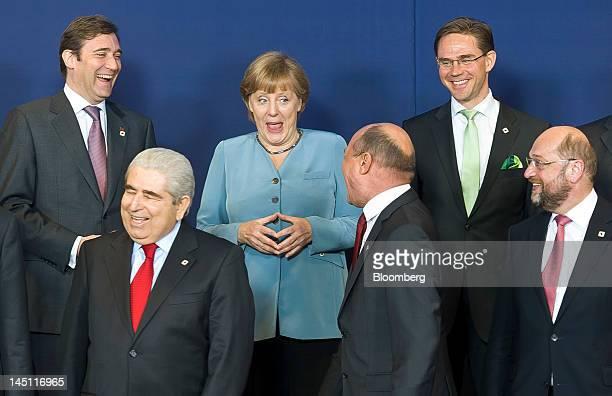 Pedro Passos Coelho Portugal's prime minister left to right Dimitris Christofias president of Cyprus Angela Merkel Germany's chancellor Traian...