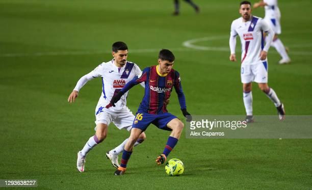Pedro 'Pedri' Gonzalez of Barcelona runs past Sergio Alvarez of SD Eibar during the La Liga Santander match between FC Barcelona and SD Eibar at Camp...