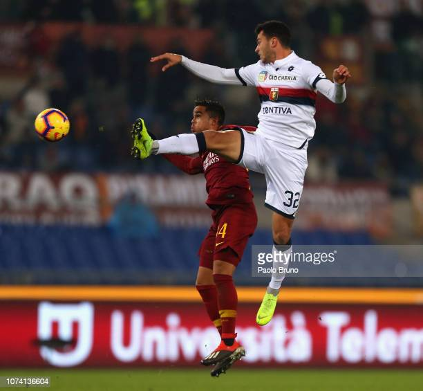 Pedro Pereira of Genoa CFC competes for the ball with Justin Kluivert of AS Roma during the Serie A match between AS Roma and Genoa CFC at Stadio...