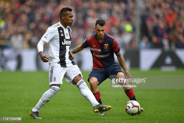 Pedro Pereira of Genoa CFC competes with Alex Sandro of Juventus during the Serie A match between Genoa CFC and Juventus at Stadio Luigi Ferraris on...
