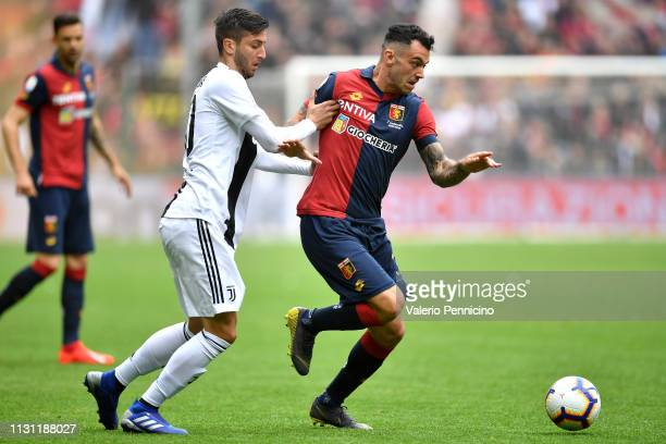 Pedro Pereira of Genoa CFC is challenged by Rodrigo Bentancur of Juventus during the Serie A match between Genoa CFC and Juventus at Stadio Luigi...