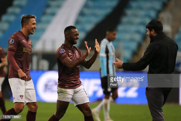 Pedro Perlaza of LDU Quito celebrates with teammates after winning a round of sixteen second leg match between Gremio and Liga Deportiva...