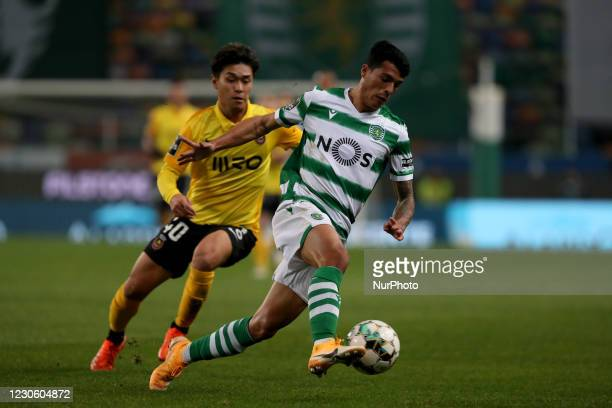 Pedro Porro of Sporting CP vies with Ryotaro Meshino of Rio Ave FC during the Portuguese League football match between Sporting CP and Rio Ave FC at...